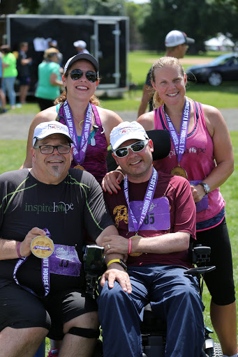 Finishers! Maria Lorzel, Heather Dodd, Blake Austin, and Chris celebrate   after  the 2017 Minnesota Nut House Challenge Half Marathon