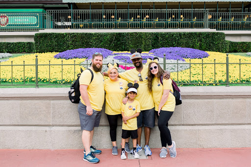 Katelyn (right) having fun volunteering with another family at Disney
